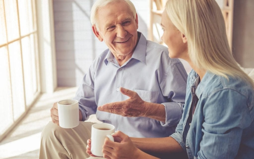 a father speaking with his daughter over coffee
