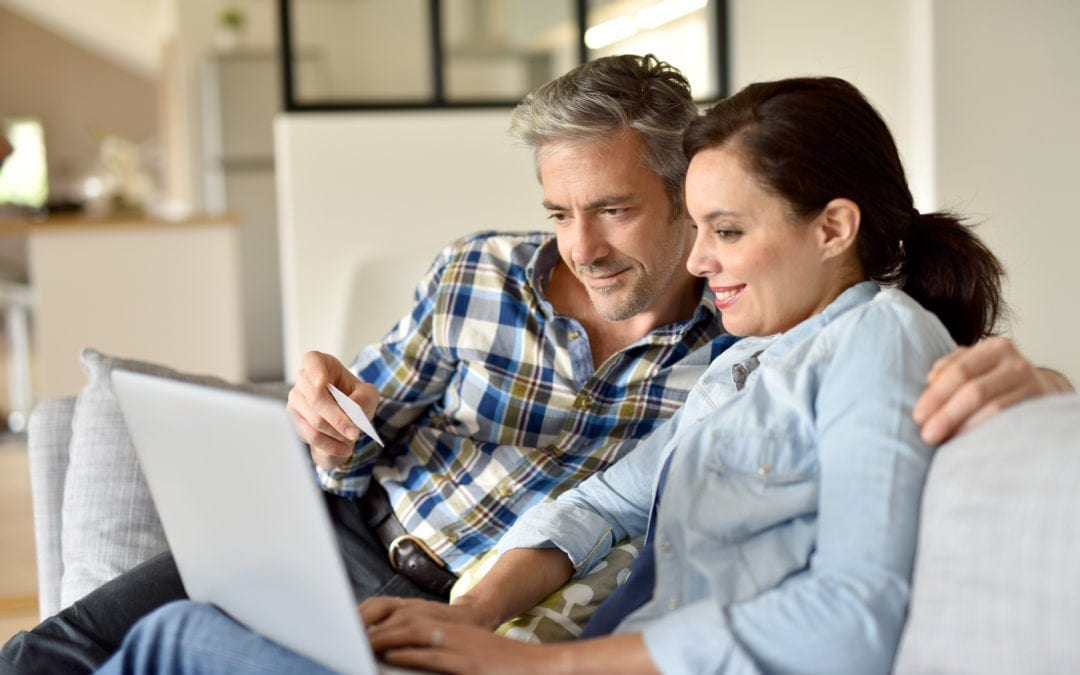 a couple looking at hearing aids on the internet