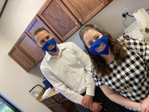 two more audiologists with clear masks on