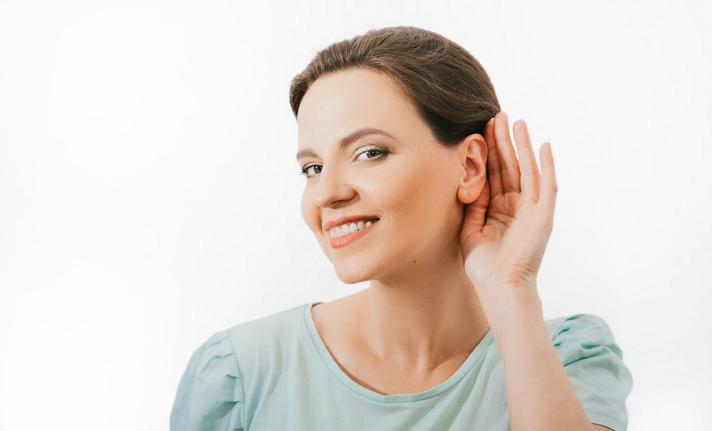 smiling woman trying to hear better