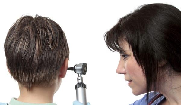 a pediatric ear doctor examining a childs ear