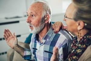 man getting hearing aid