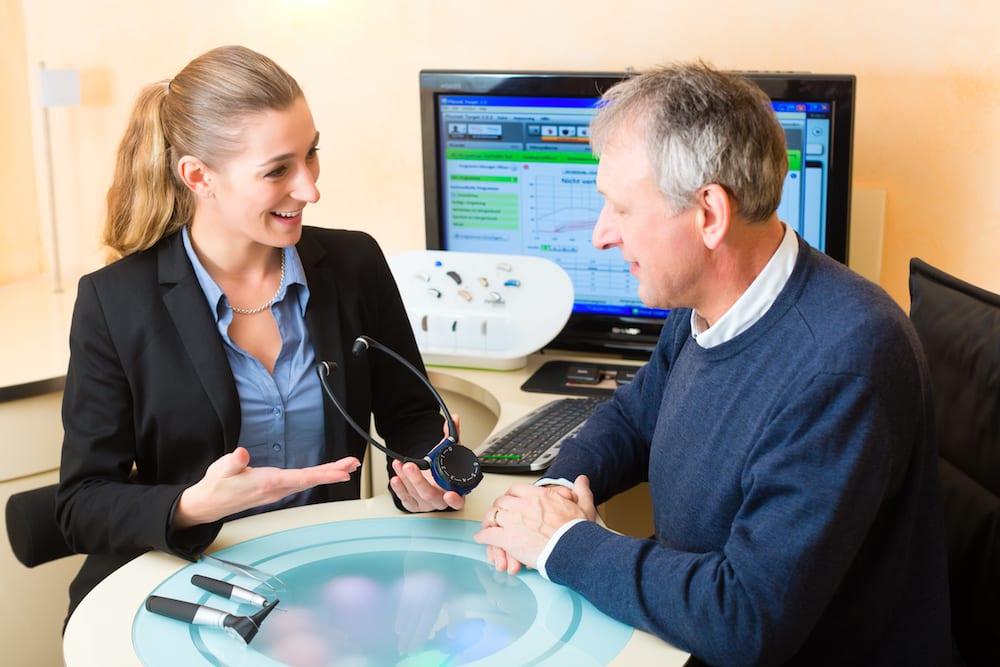an audiologist reviewing an audiogram with her patient