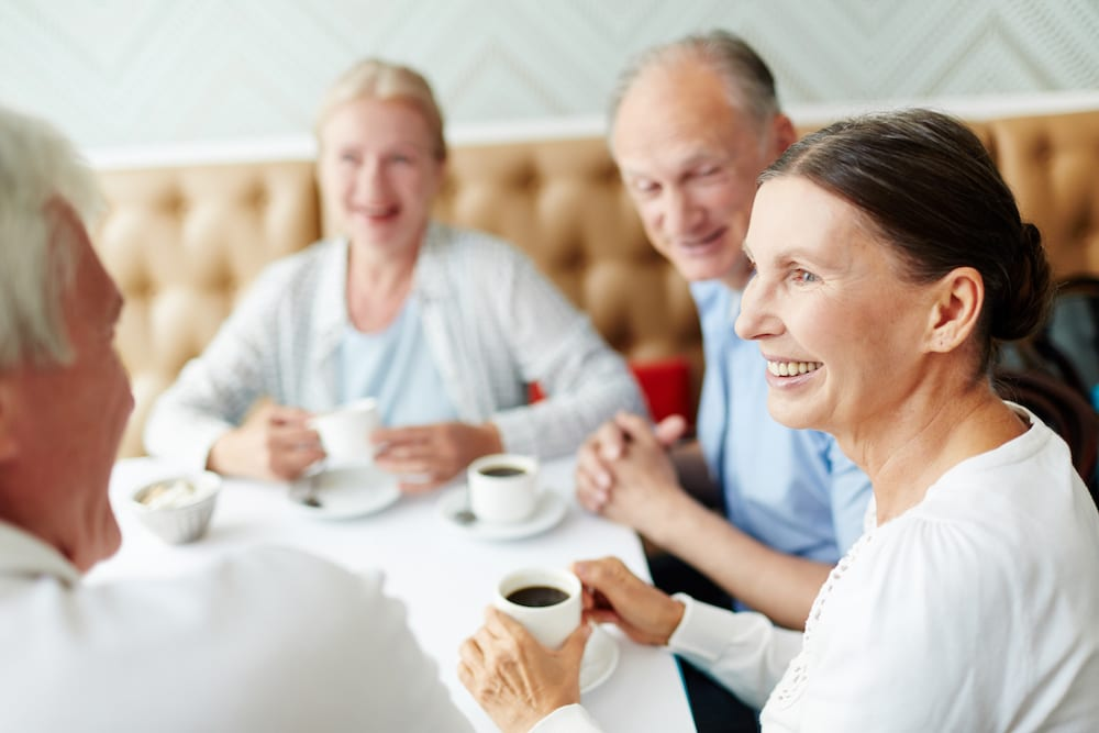 four family members eating lunch in a restaurant