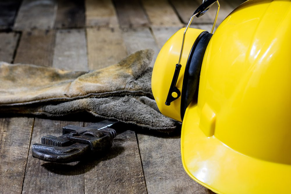 hard hat with hearing protection placed on table