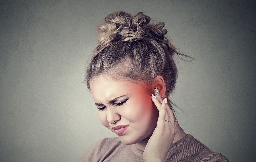 a woman experiencing ear discomfort