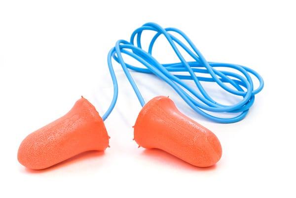 a pair of orange foam earplugs