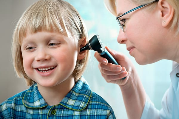 a child receiving a hearing examination