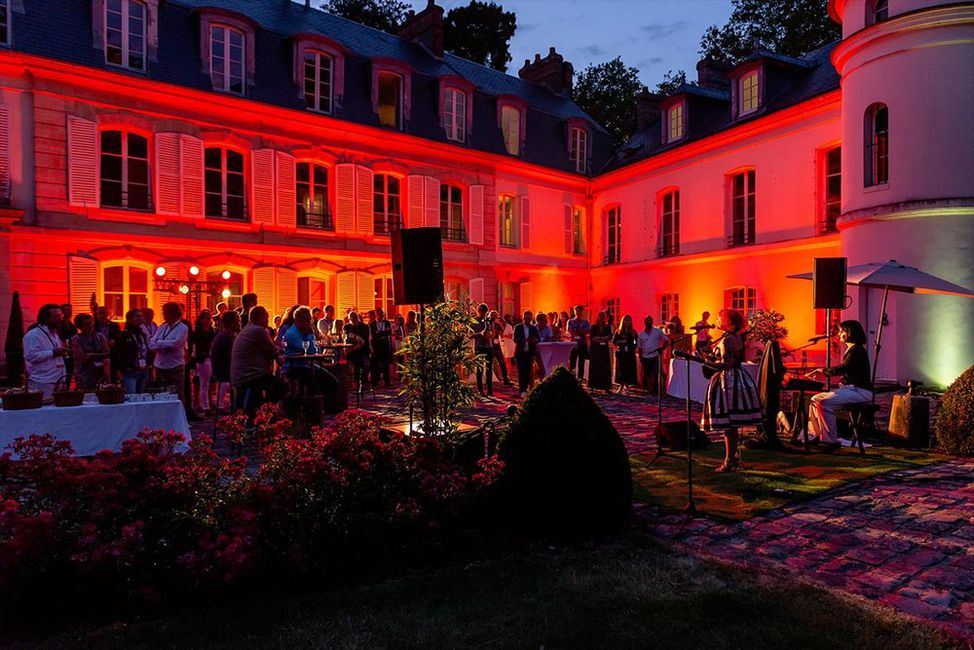 Attendees during the evening festivities at the Boma France Campfire.