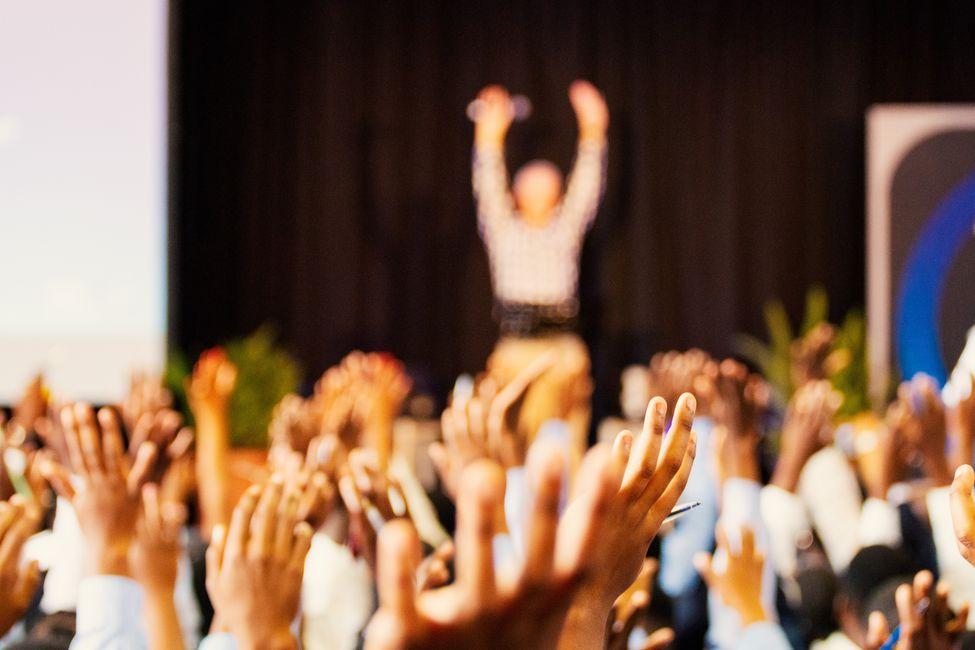 Students raising their hands.