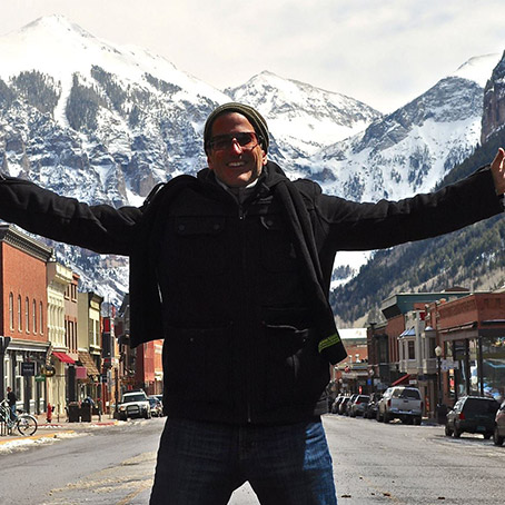 Berman in front of a snowy mountain
