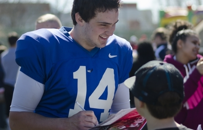 FOOTBALL: Milas brings his 'signature smile' to team as new starting quarterback