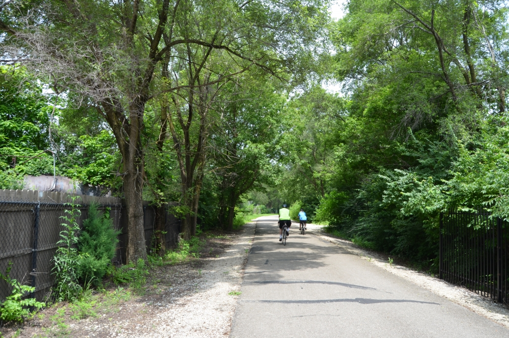 People ride their bike on a Cardinal Greenway trail toward Ball State's campus. PHOTO BY MIKAELA MARANHAS