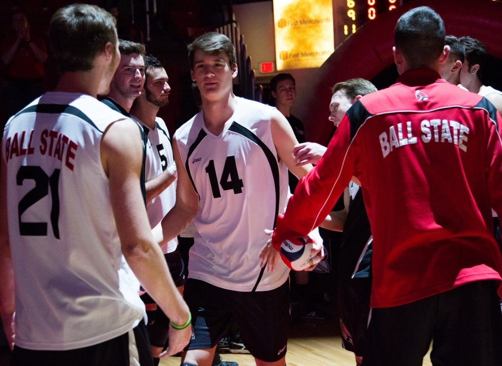 Freshman outside attacker Matt Szews is greeted by his team with the rest of the starters at the game against Ohio State on Feb. 2 in Worthen Arena. The Cardinals lost 3-0 to the Buckeyes. Kaiti Sullivan // DN