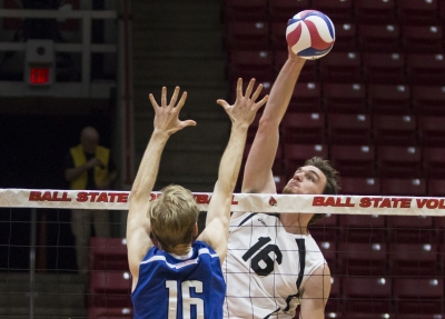 Middle attacker Matt Walsh reaches for a kill in the second set against Fort Wayne at Worthen Arena on Feb. 7. The Cardinals won 3-0.Grace Hollars // DN