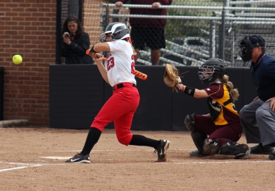 Then-junior Amanda Arnett attempts to hit the ball in the game against Central Michigan on April 22 at the Varsity Softball Complex.Ball State lost against Oakland (5-1), losing 1-0.Allye Clayton // DN File