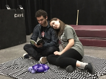 """Caroline, played by junior acting major Abbi Minessale, leans on Anthony,played by sophomore acting major Tyler Rainer, as he readsWalt Whitman to herin Cave Theatre's newest show, """"I and You.""""The show, which will run from Feb. 16-25, tells the story of a girl with a liver transplant who works on a literature project with her classmate while she's stuck at home.Alexandra Smith // DN"""