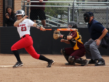 Senior left fielderAmanda Arnett looks outfield after making contact with the ball in the game against Central Michigan on April 22 at the Varsity Softball Complex. The Cardinals will travel to Arizona this weekend to compete in the Wildcat Invitational. Allye Clayton // DN File