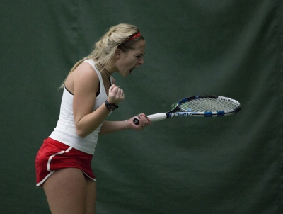 Sophomore Peyton Gollhofer reacts after winning a point during her singles match against Wright State on Feb. 5.Peyton Gollhofer's dad, Ret. Lt. Col. Robert Gollhofer, served in the Marines for 15 years, which meant spending months at a time away from Peyton and her younger brother Robert Kyle.Emma Rogers // DN File