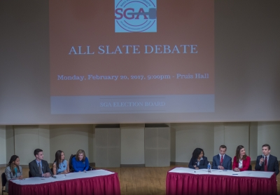 IGNITE and OPTiC speak at the All Slate Debate on Feb. 20 in John J. Pruis Hall. These are the slates running for 2017-18 SGA executive board. Terence K. Lightning Jr. // DN
