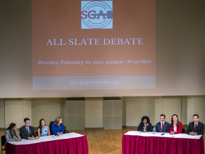 OPTiC and IGNITE speak at the All Slate Debate on Feb. 20 in John J. Pruis Hall. These slates are running for the 2017-18 SGA executive board. Terence K. Lightning Jr. // DN