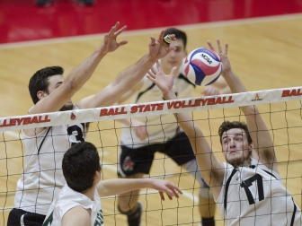Setter Connor Gross and middle attacker Alex Pia attempt to block a hit against George Mason on Jan. 26 in John E. Worthen Arena. Ball State won the match 3-1, improving their record to 7-1. Emma Rogers // DN File