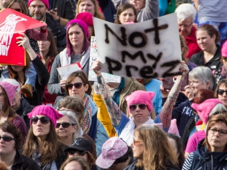 An estimated 4,500 to 5,000 people gathered outside the Indiana Statehouse on Jan. 21 for the Indianapolis Women's March, according to Indiana State Police. The rally was held in conjunction with hundreds of marches nationwide to protest the presidency of Donald Trump and support the rights of women, immigrants, LGBTQ and people of various religions. Grace Ramey // DN File