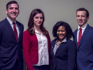 Juniors Theodore Hoffman, Zoe Taylor, Gabrielle Lloyd and Caleb Conley are running for 2017-18 SGA executive board. Their slate, IGNITE, participated in the All Slate Debate on Feb. 20 in John J. Pruis Hall. Terence K. Lightning Jr. // DN