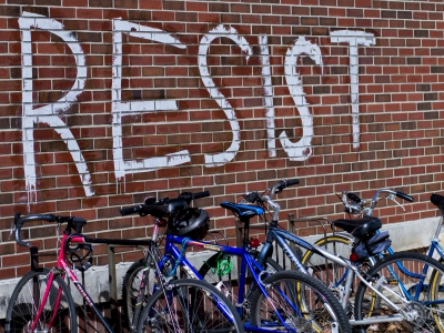 "Students woke up on Feb. 24 to find ""resist"" signs on the College of Architecture Building, Atrium, Cooper Science Building and near the University Green. It's not currently known who was responsible for the signs. Terence K. Lightning Jr. // DN"