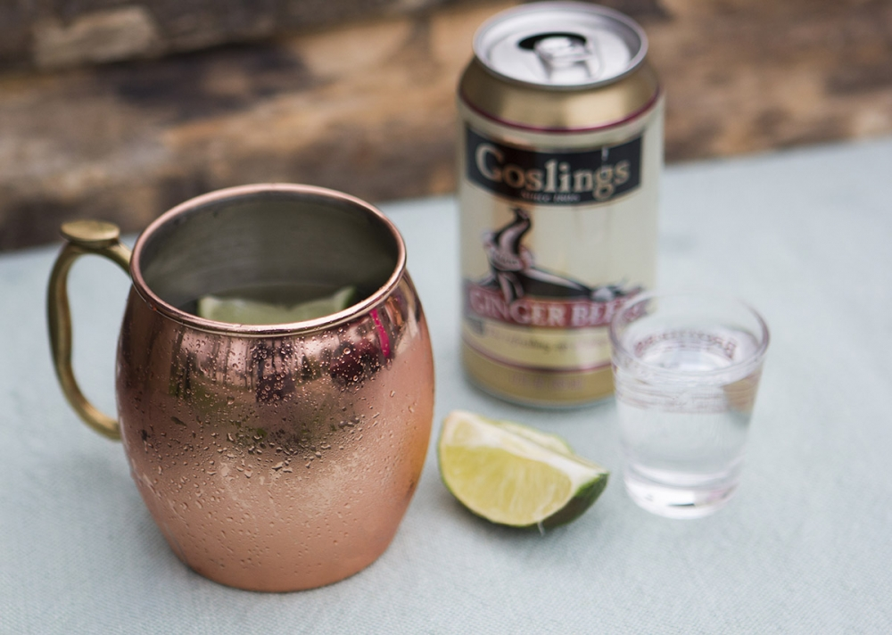 A moscow mule is made with vodka, ginger beer and lime juice.