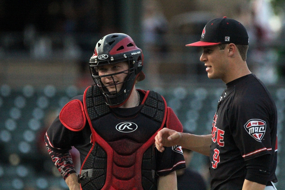 Junior starting pitcher Colin Brockhouse talks with sophomore catcher Griffin Hulecki in the first during the Cardinals' game against Indiana University on April 25 at Victory Field. The Hoosiers came back to win the game in 10 innings. Paige Grider // DN