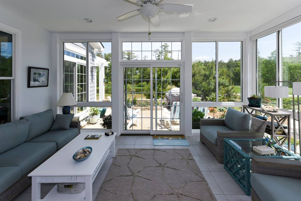 interior of a sunroom with wall-to-wall glass windows