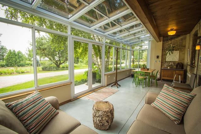 interior of a four seasons sunroom with glass windows