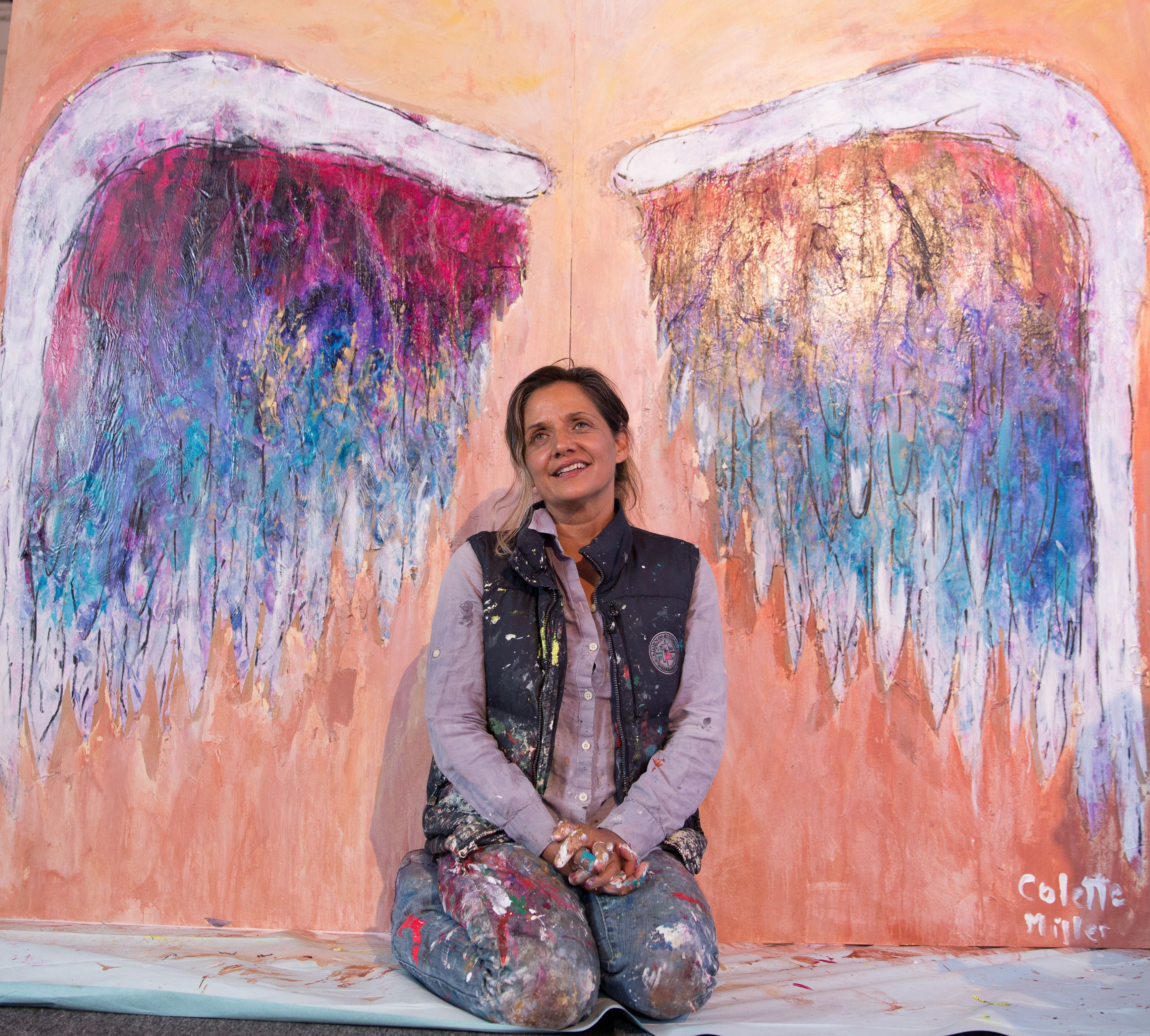 5538ecccbf Colette putting final touches on her Global Angel Wings at The Mission Inn
