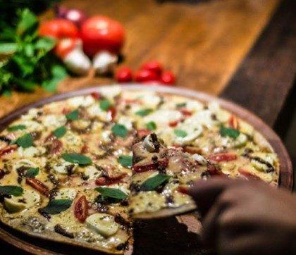 10% de desconto em qualquer refeição na Mística Pizza