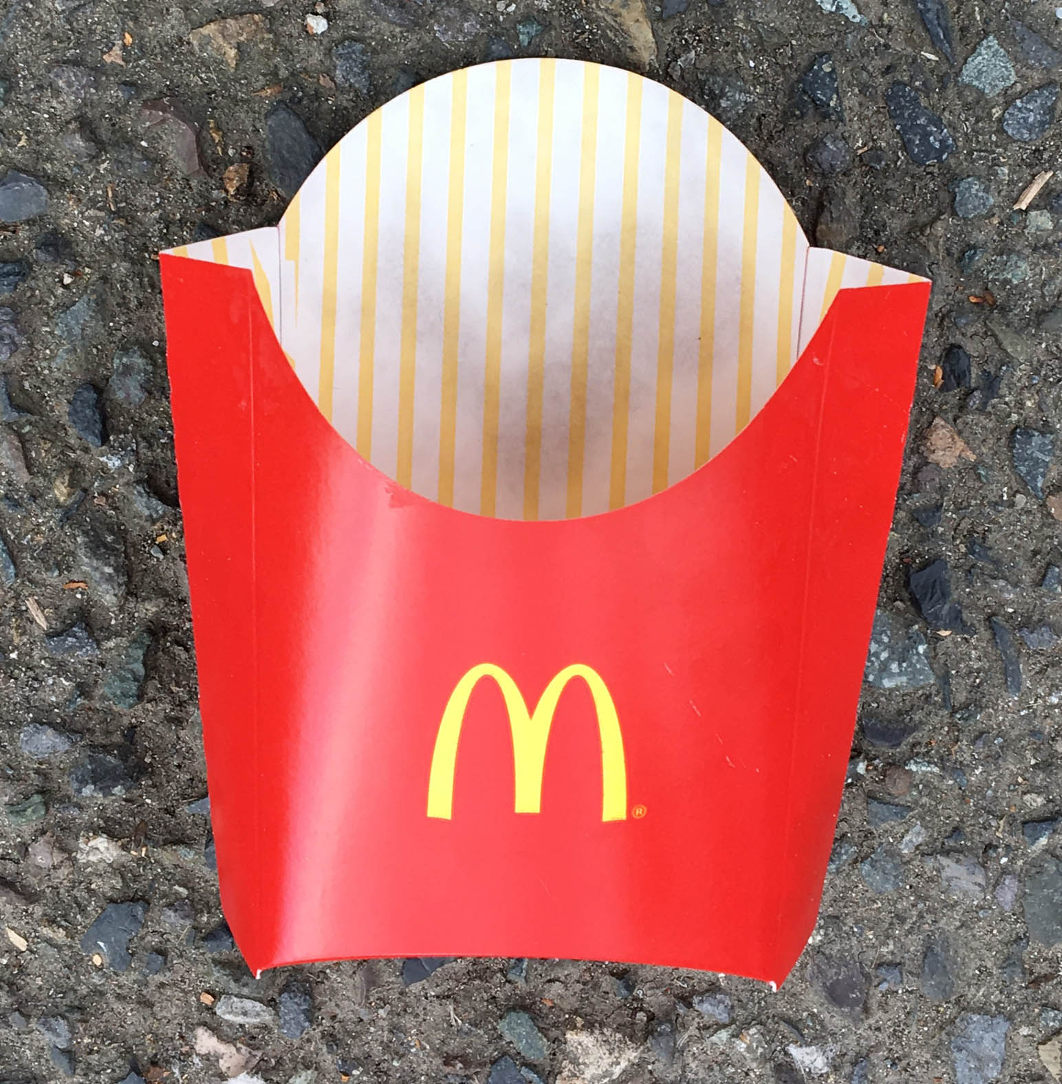 McDonalds French Fry Container Laying in the Parking Lot