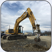 Antraquip AQ-3XL on Kobelco 260 cutting hard shale for Hotel site preparation in New York State
