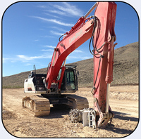 AQ5 on Linkbelt 470. Hard rock ledge removal in Las Vegas