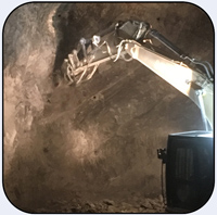 AQ-4 Rotary Scaler on CAT336 Underground Limestone.