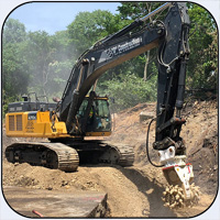 AQ-5 on JD470 Trenching Limestone for Pipeline Project