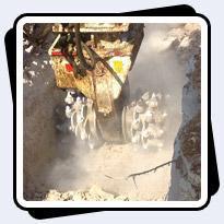 AQ-4XL Rock Grinder on Hitachi EX470 Trenching 100MPa Limestone outproducing Hydraulic Breaker