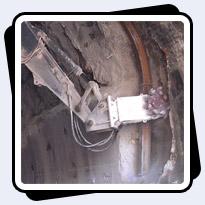 AQ4 on John Deere 200 for Railroad Tunnel Enlargement