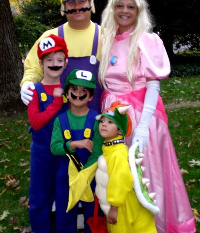 Sasha Mitchell with her family as Mario Brothers characters on Halloween.