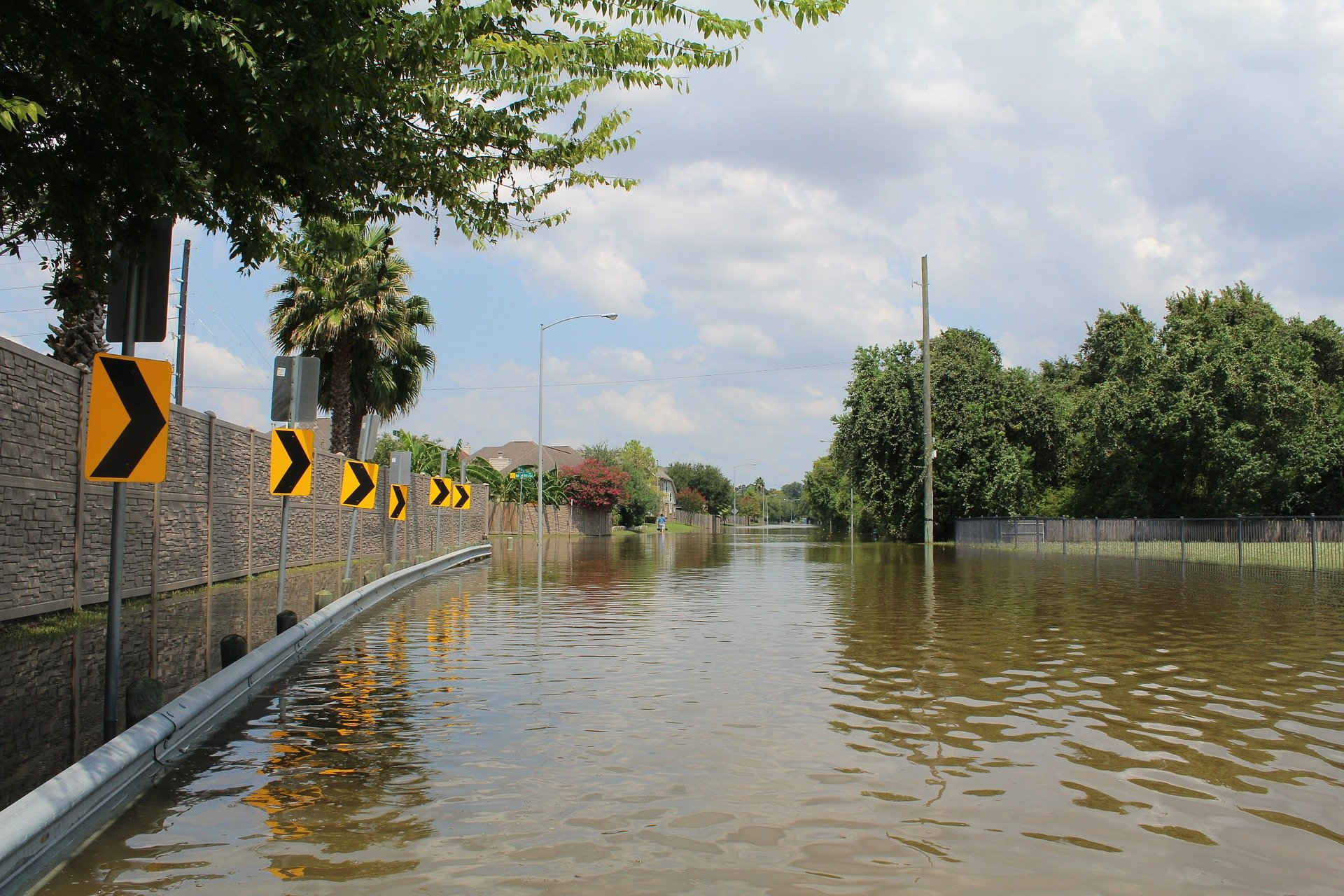 hurricanes: a flooded roadway, the aftermath of hurricane harvey