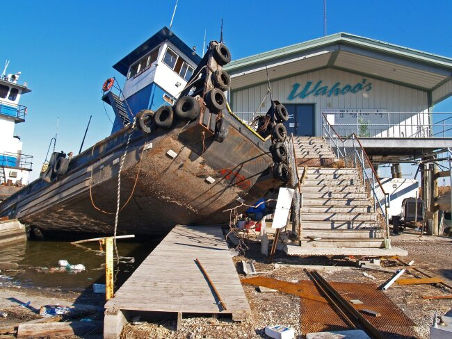 a boat rests on top of a pier after a hurricane