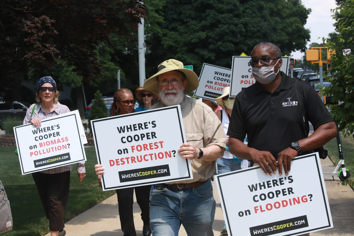 demonstrators march where is governor cooper