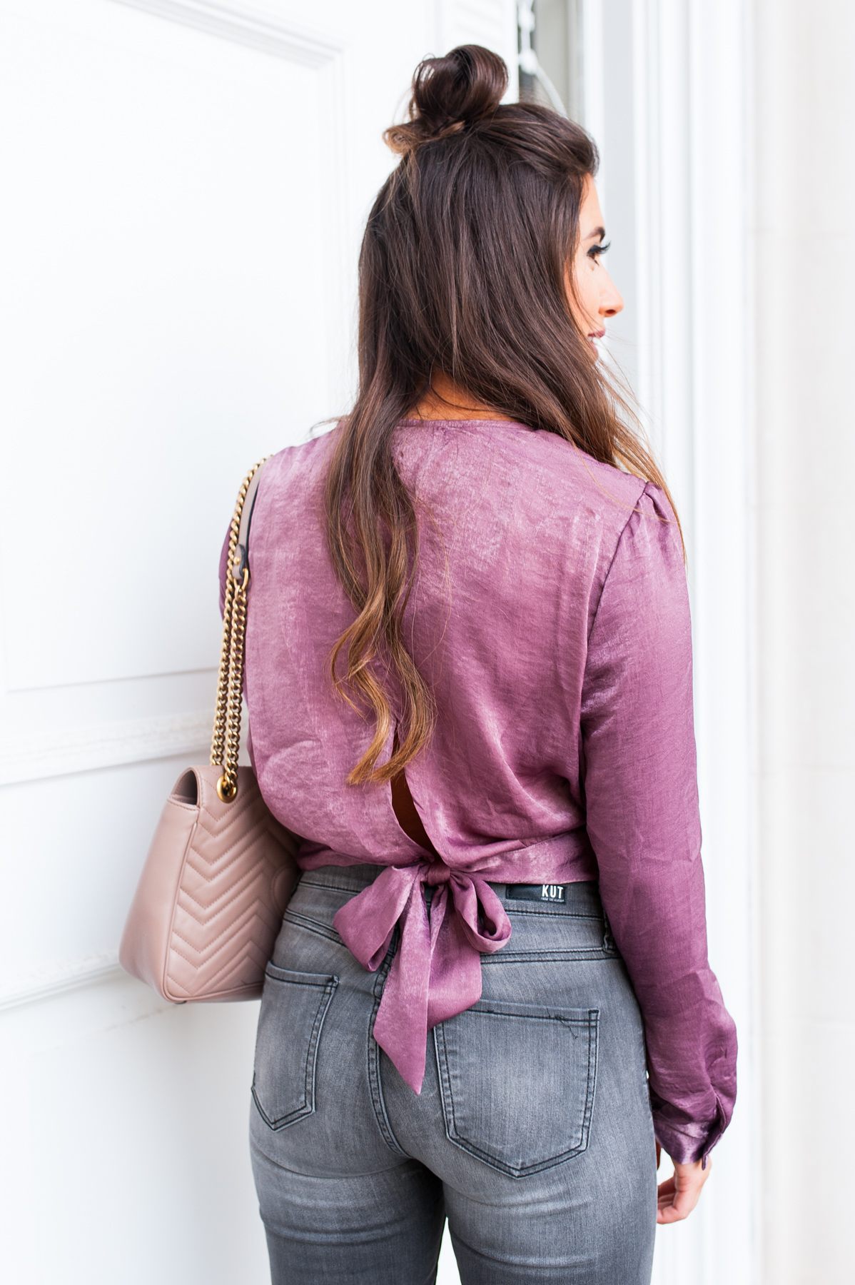 plum fall color, gray wash denim jeans with purple top