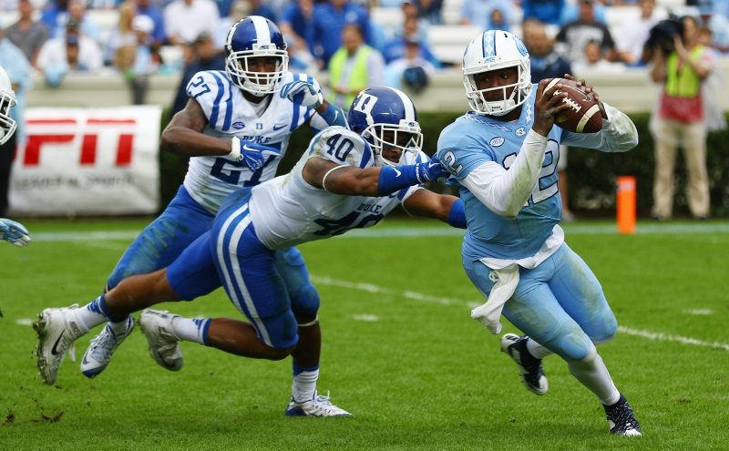 North Carolina quarterback Marquise Williams threw for 494 yards—404 in the first half—and accounted for five total touchdowns as the Tar Heels picked apart Duke's defense in a 66-31 win Saturday.