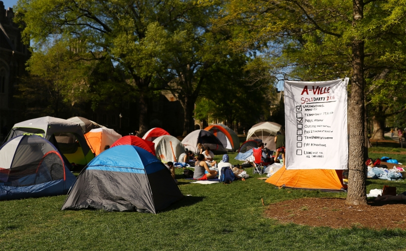 Students pitched tents in front of the Allen Building in support of protestors who staged a week-long sit-in inside the Allen Building in response to alleged instances of discrimination in the Parking and Transportation Services department.