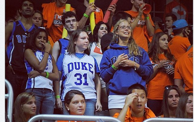"""A photo from DukeBluePlanet of Michelle Picon and her friends at the Miami game captioned """"Found brave Duke fans in the Miami student section."""""""